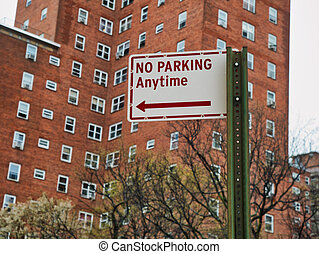no parking anytime sign on the street in manhattan new york ...