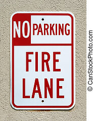 No Parking - Fire Lane sign on a stucco wall