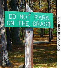 """NO PARKING ON GRASS SIGN - A green and white """"No Parking On..."""