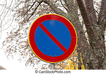 No parking road sign on autumn trees background.