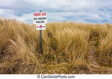 No parking sign on a dune