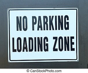 """NO PARKING SIGN - A """"No Parking Loading Zone"""" sign"""