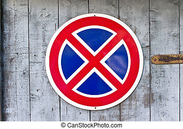 No parking traffic sign over old wooden background