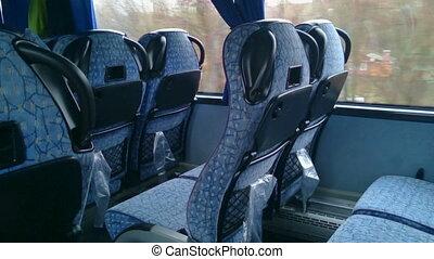 """No people inside a low budget bus, empty seats, off-season...."