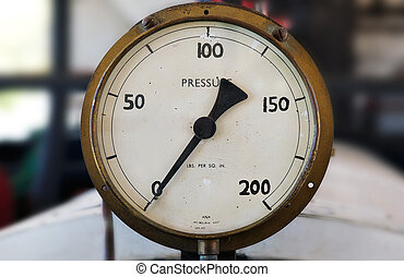 an old boiler pressure gauge with hand written markings on zero pressure