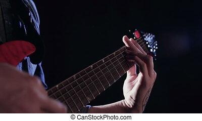 No Rest for Guitar - Close up of unrecognizable hands...