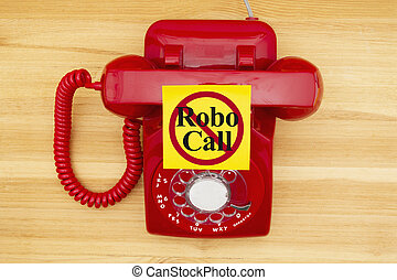 No Robo Call message on a sticky note on a red old retro rotary phone