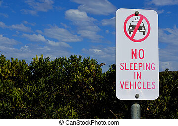 No sleeping in vehicles sign