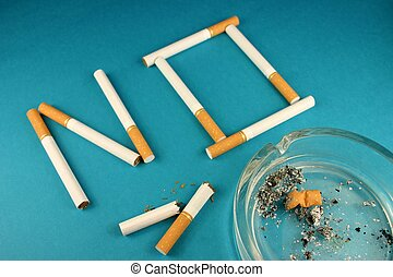 NO Smoking 2 - Cigarettes forming word 'NO' on blue ...
