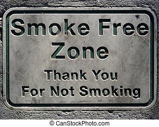 No smoking sign set in concrete
