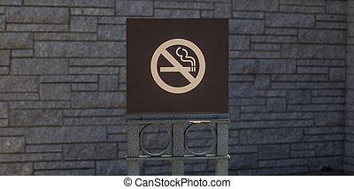 No smoking sign against a gray brick wall