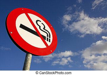no smoking sign against the blue sky