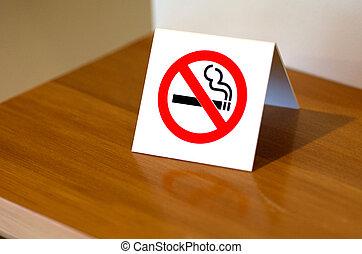 No Smoking Sign - No smoking sign on a shelf of hotel room.