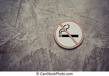 No smoking sign on the gray cement wall