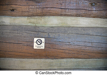 No smoking sign on wooden wall