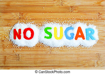 No sugar text from magnetic letters concept on wooden background