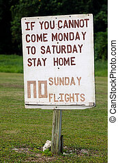 No Sunday Flights protesting sign in Aitutaki Lagoon Cook Island