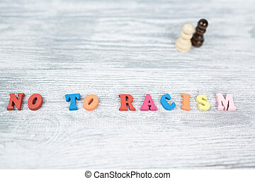 No to racism in colored letters on gray background