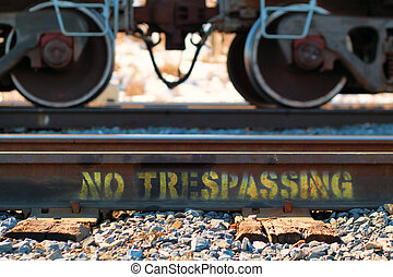 No Trespassing - No trespassing written on rail tracks with...