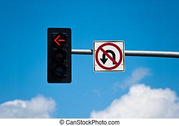 No Turn, No U-Turn - A left turn lane signal light and no u-...