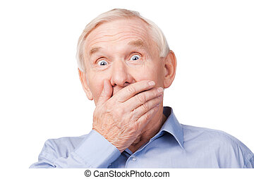 No way! Excited senior man formalwear covering mouth with...