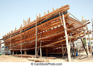Noahs Boat? - A traditional arabic dhow being constructed on...