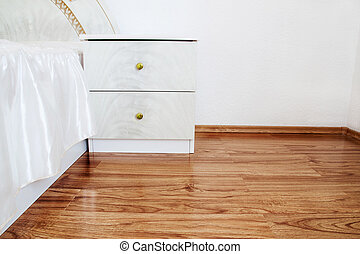 noble bedside table with laminate floor
