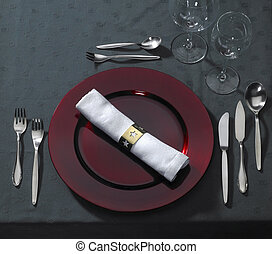 festive place setting on dark table cloth seen from above