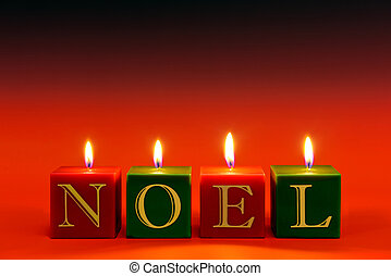 NOEL candles - Candles that spell the word NOEL burning...