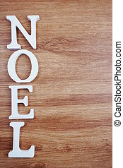 Noel Word alphabet letters with space copy on wooden background
