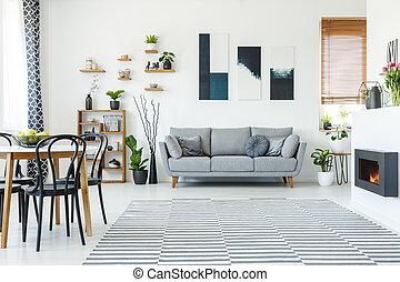 noir, chaises, table, dans, spacieux, appartement, intérieur, à, affiches, au-dessus, gris, sofa., vrai, photo
