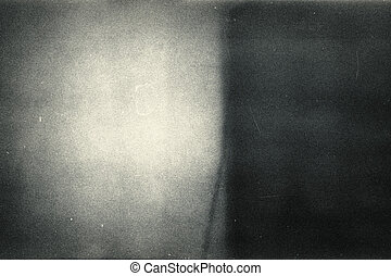 Noisy film frame with heavy scratches, dust and grain