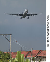 Residential area close to an airport, under the flight path of arriving airplanes.
