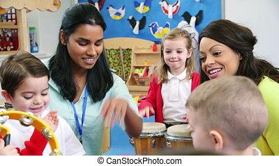 Noisy Nursery Lesson - Nursery students enjoying a music...