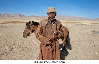 Nomad with his horse - Nomad with his faithful horse in the...