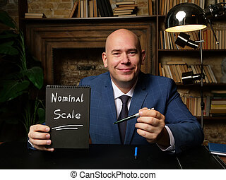 Nominal Scale inscription on black notepad.