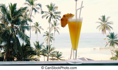 non-alcoholic pineapple cocktail in a glass against a...