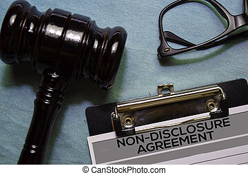 Non-Disclosure Agreement text on Document and gavel isolated on office desk.