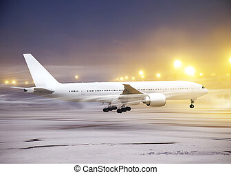 non-flying weather in airport - white plane in airport at...
