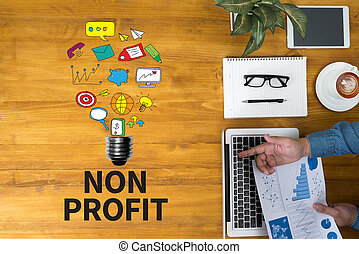 NON PROFIT Businessman working at office desk and using...
