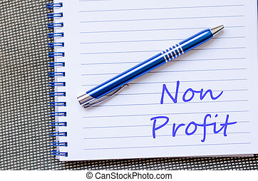 Non profit text concept - Blue notepad and Non profit text...