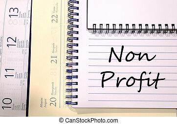 Non profit write on notebook - Non profit text concept write...