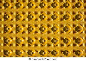 Non-Slip Sidewalk - Closeup of yellow non-slip curb ramp ...