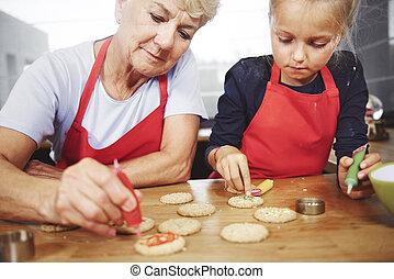 nonna, biscotti, decorare, natale, ragazza