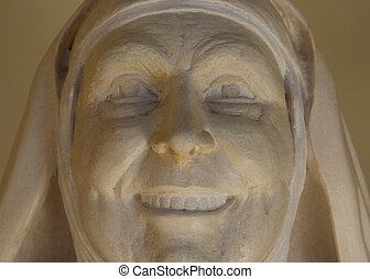 nonne, sten ansigt