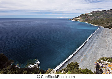 Nonza beach in Cap Corse Peninsula - Nonza beach makes a ...