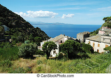 Nonza village, Corsica - Nonza village with sea view. ...