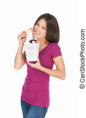 Noodle box. Beautiful mixed race woman eating noodles from ...