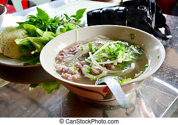 Noodle soup vietnam style vietnamese called Pho on the table in local restaurant