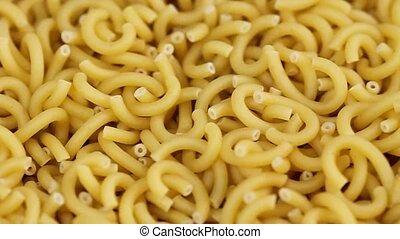 Heap of raw noodles as background
